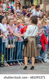 Gdansk, Poland - July 18, 2017: Woman with Gdansk and British flags at old town of Gdansk before arrival royal couple (Duchess Kate and Prince William).
