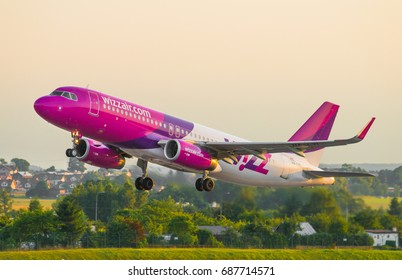 GDANSK, POLAND - JULY 20, 2017: Passenger airplane of Wizz Air airlines start up and flying from Lech Walesa International Airport in Gdansk. Wizzair is a Hungarian low cost airline