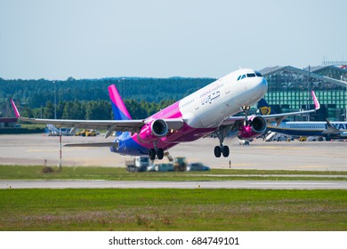 GDANSK, POLAND - JULY 22, 2017: Passenger airplane of Wizz Air airlines start up and flying from Lech Walesa International Airport in Gdansk. Wizzair is a Hungarian low cost airline.