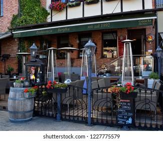 GDANSK, POLAND - JULY 7, 2018. Shore of old harbor, over Motlawa river with historic shore Quayside (Dlugie Pobrzeze) ,the medieval wooden port crane of Gdansk. Barytka Restaurant.