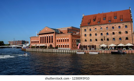 GDANSK, POLAND - JULY 7, 2018. Cityscape with Polish Baltic Philharmonic and Krolewski Hotel on Ołowianka island , shore of Motlawa river, Old Town of Gdansk