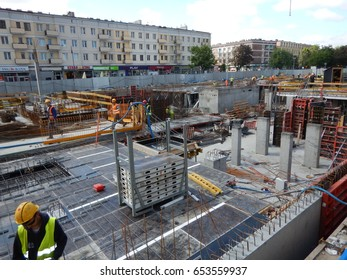 GDANSK, POLAND - JUNE 01, 2017: New apartment building place. Construction Square in the city center. The formation of the building, construction equipment and workers at work.