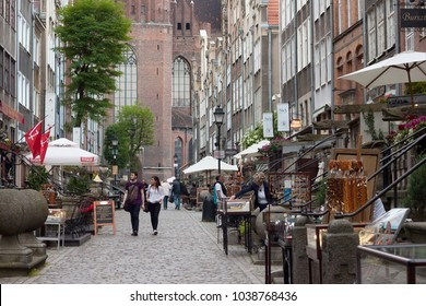 GDANSK, POLAND - JUNE 07, 2014: Unknown people walking on the Mariacka street in the historical part of Gdansk. Is the most atmospheric street in city and one of most photogenic in Poland.