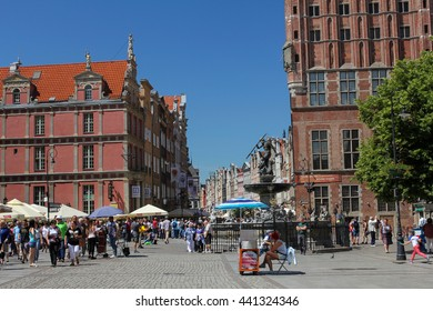 GDANSK, POLAND, JUNE 15, 2016: Neptun Fountain and Dluga Street - most popular touristic place in Gda?sk with shops selling amber jewelery, souvenirs and climate restaurants.