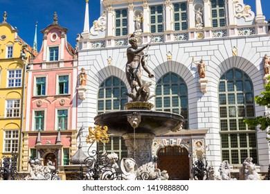 Gdansk, Poland - June 2, 2019: Neptune fountain of the old town in Gdansk, Poland. Gdansk is the historical capital of Polish Pomerania with medieval old town architecture.