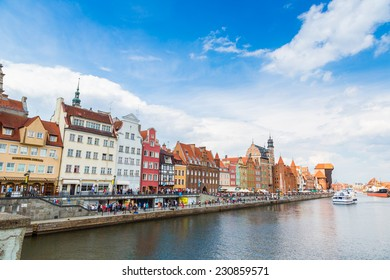 GDANSK, POLAND - JUNE 9: Tourist ship and colourful historic houses reflection Motlawa river in port of Gdansk on 9th June 2014, Baltic Sea, Poland.