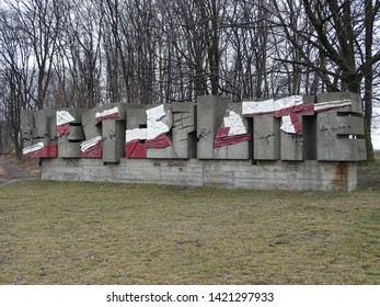 Gdansk / Poland - March 16 2017: Big beton letter WESTERPLATTE partly pained with national Polish red and white colors, entrance to historical area in Gdansk where II world war began 1.09.1939