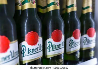 Gdansk, Poland - May 24, 2018: Bottles of Pilsner Urquell beers in the fridge. Pilsner Urquell is a Czech lager brewed by the Pilsner Urquell Brewery.