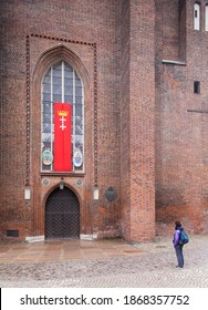 Gdansk, Poland, May 24, 2020 Single person stand nera the main entrance to Mariacki Church in Gdansk