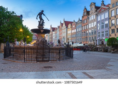 Gdansk, Poland - May 5, 2018: Fountain of the Neptune in old town of Gdansk at dawn, Poland. The bronze statue of Neptune made in 16th century is one the most recognizable symbols of Gdansk.