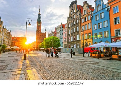 Gdansk, Poland - May 7, 2014: Main City Hall at Dlugi Targ Square in the old city center of Gdansk at sunset, in Poland. People on the background.
