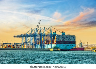 GDANSK, POLAND - MAY 7, 2016: The container ship Maersk one of the worlds largest container ship is loaded / unloaded at DCT Gdansk deep-sea terminal.
