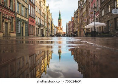 Gdansk, Poland - November 06 2017: Tower of City Hall is reflected in the puddle, located on Dluga street in a heart of old town