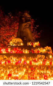 Gdansk, Poland - November 1, 2018: Victims of the East Golgotha monument with flaming candles at All Saints' Day. Monument at Gdansk Lostowice cemetery.