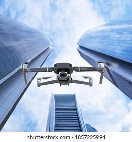 Gdansk, Poland - November 14, 2020: DJI Mavic 2 pro drone with hasselblad camera with skyscraper buildings background. Illustrative editorial content