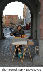 Gdansk, Poland - October 26, 2018: woman is selling pastry outdoor in Gdansk