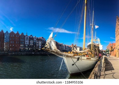 GDANSK, POLAND - SEPTEMBER 2, 2018: Ships at a port on Motlawa river in Gdansk, Poland. Gdansk is the historical capital of Polish Pomerania with medieval old town architecture.