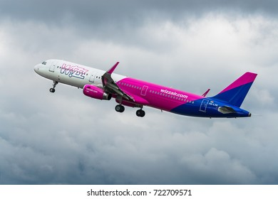 GDANSK, POLAND - SEPTEMBER 22, 2017: Passenger airplane of Wizz Air airlines flying in the cloudy weather with thick clouds. Wizzair is a Hungarian low cost airline.