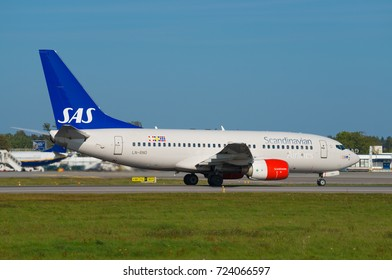 GDANSK, POLAND - SEPTEMBER 28, 2017: Passenger plane SAS Scandinavian Airlines System airplane on the runway at the International Airport Lech Walesa in Gdansk. SAS is a Nordic airline.