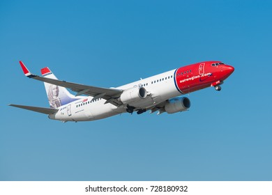 GDANSK, POLAND - SEPTEMBER 28, 2017: Norwegian Air Shuttle airplane Boeing 737-800 is flying on the blue sky from the International Lech Walesa Airport in Gdansk.