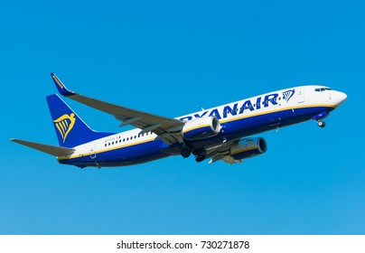 GDANSK, POLAND - September 28, 2017: EI- FZI - Boeing 737 - Ryanair airplane in the air on the beauty blue sky is flying- leaving from the Lech Walesa International Airport in Gdansk.