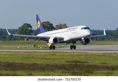 GDANSK, POLAND - SEPTEMBER 28, 2017: German airlines Lufthansa CityLine branded airplane is landing on the runway of Lech Walesa International Airport in Gdansk.