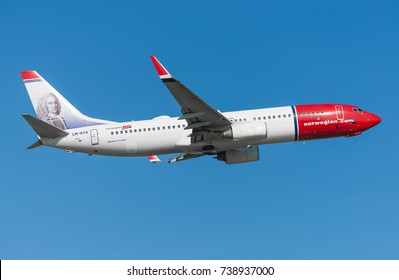 GDANSK, POLAND - SEPTEMBER 28, 2017: Norwegian Air Shuttle airlines airplane Boeing 737-800 is flying on the blue sky from the International Lech Walesa Airport in Gdansk.