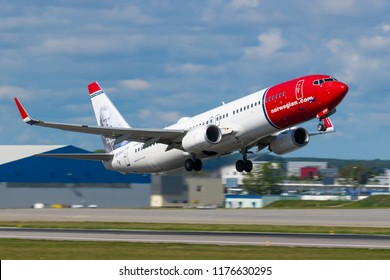 GDANSK, POLAND - SEPTEMBER 3, 2018: Norwegian Air Shuttle airlines offers cheap flights. Airplane Boeing 737-800 takes off on from the International Lech Walesa Airport in Gdansk.