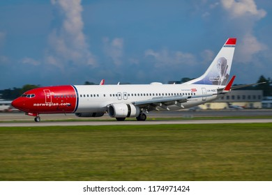 GDANSK, POLAND - SEPTEMBER 5, 2018: Norwegian Air Shuttle cheap air carrier airlines with airplane Boeing 737-800 which is staying on the runway of the International Lech Walesa Airport in Gdansk.