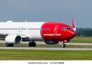 GDANSK, POLAND - SEPTEMBER 6, 2018: Norwegian Air Shuttle are cheap flights airlines with airplane Boeing 737-800 which is staying on the runway of the International Lech Walesa Airport in Gdansk.