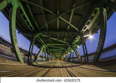 Gdanski tram bridge in Warsaw, rail bridge by night