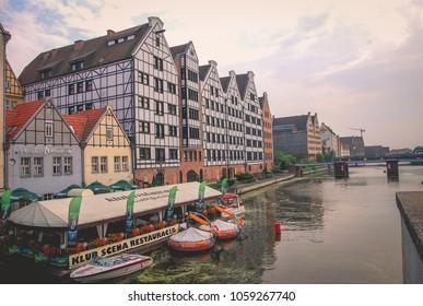 Gdansk/Poland - 2 July 2013: Granaries on the Granary Island; historic architecture at the Motlawa river.