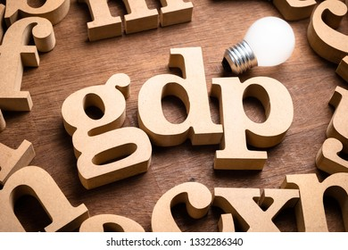 GDP in lower case font with glowing light bulb, Knowledge about GDP or Gross Domestic Product concept