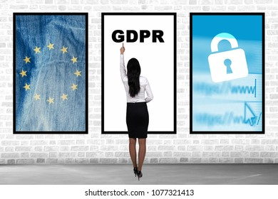GDPR concept. Woman shows on General Data Protection Regulation. New EU law from 2018.