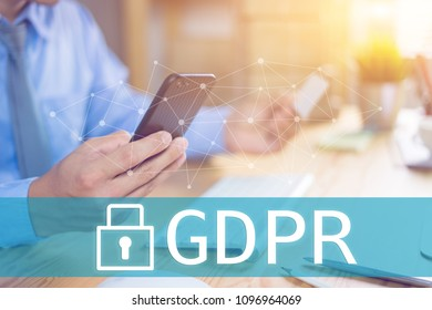 GDPR Concept,Businessman hand holding digital tablets mobile smartphone sign general data protection regulation and key icon, Cyber security and information privacy,25 may 2018.