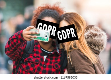 GDPR - couple making selfie photo on smartphone is hidden behind the inscriptions General Data Protection Regulation. Cyber security and privacy.
