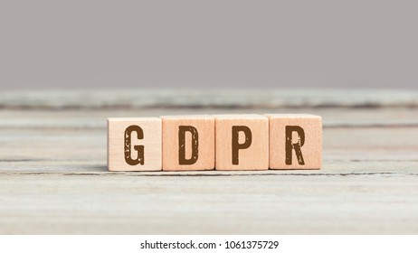 GDPR (European new General Data Protection Regulation, effective May 2018 on privacy) message on wood cube dices on aged table.