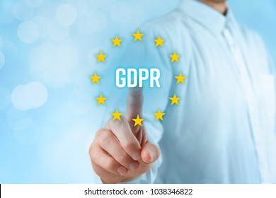 GDPR (general data protection regulation) concept. Businessman or IT technologist click on GDPR text and EU stars.