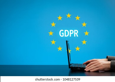 GDPR (general data protection regulation) concept. Businessman or IT technologist with text GDPR and EU stars.