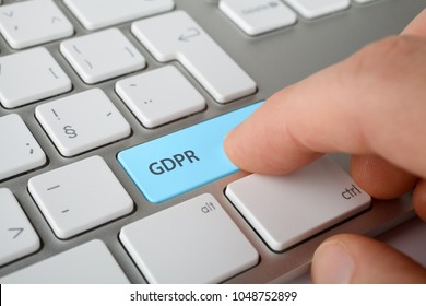 GDPR (general data protection regulation) concept. Internet user press key on keyboard with text GDPR.