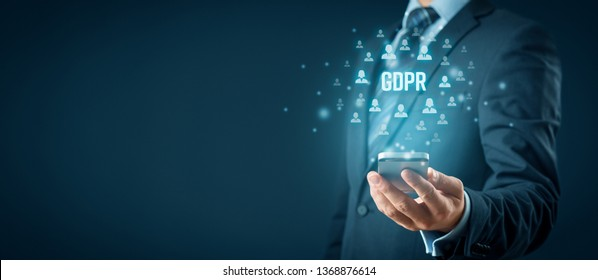 GDPR (general data protection regulation) and smart phone concept. Businessman or IT technologist with text GDPR and icons of people.