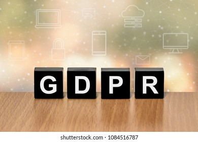 GDPR on black block with digital icon and blurred background
