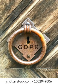 Gdpr regulation text written over old wooden Lock with iron circle. gdpr door to world of regulations.