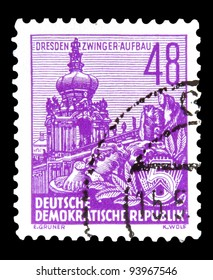 """GDR - CIRCA 1953: A stamp printed in GDR (German Democratic Republic - East Germany) shows Zwinger with inscription """"Dresden, Zwinger construction"""" series """"Workers For The Five-year Plan"""", circa 1953"""