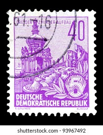 """GDR - CIRCA 1955: A stamp printed in GDR (German Democratic Republic - East Germany) shows Zwinger with inscription """"Dresden, Zwinger construction"""" series """"Workers For The Five-year Plan"""", circa 1955"""