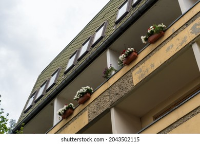 gdr prefabricated building still unrenovated with balcony and flower box