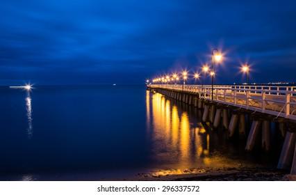 Gdynia Orlowo pier. Vintage photo of Baltic sea shore seascape.sunrise at seaside