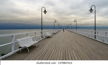 Gdynia Orlowo Pier, wooden pier on calm seaside of polish city Gdynia (part of Tricity in Baltic coast) during late evening with clouds full of rain, Pomeranian Voivodeship, Poland, Eastern Europe