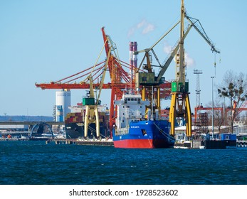Gdynia, Poland 14.02.2021 Container base  with cranes and gantry in the port by the sea