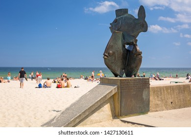 Gdynia, Poland - June 8, 2019: People on the beach at Baltic Sea in Gdynia, Poland. Gdynia is an important seaport of Baltic Sea in Poland.